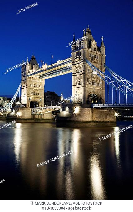 Reflections of the Floodlit Tower Bridge in the River Thames at Dusk London England