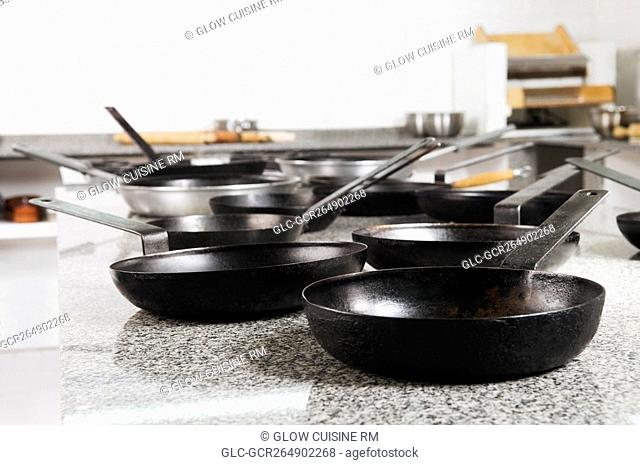 Frying pans in the kitchen