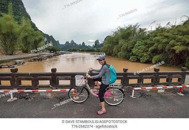 Bicycling along the Li River at Xingping, Guangxi Autonomous Region, China