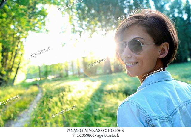 Young attractive woman takes a walk in nature