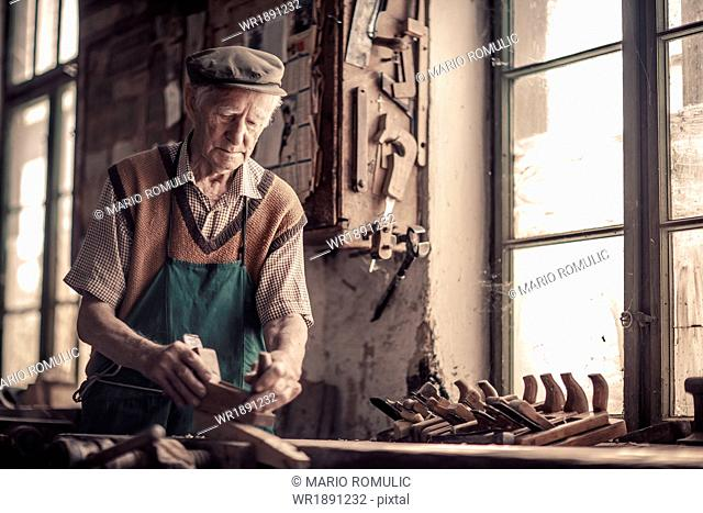 Senior carpenter in his Workshop, Karanac, Baranja, Croatia