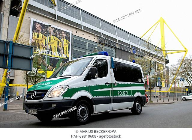 Apolice car parks outside the Signal Iduna Park in Dortmund, Germany, 12 April 2017. Three explosions occurred near the road blockade next to the team bus of...