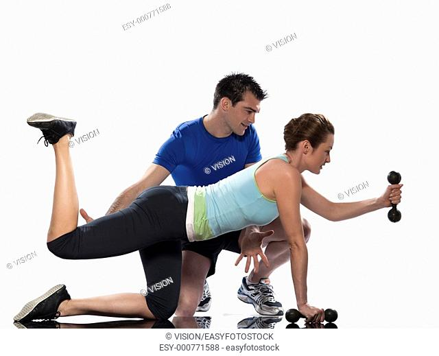 man and woman, a couple exercising workout on white background with weights