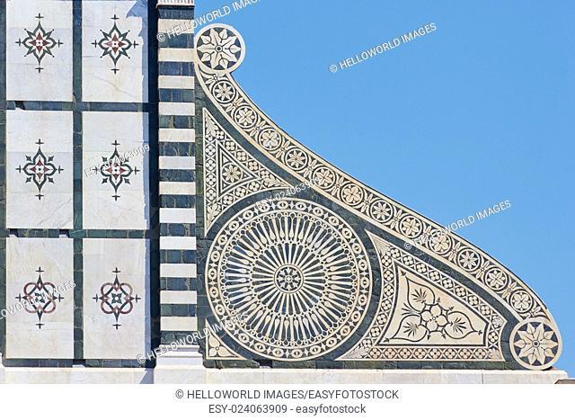 Decorative detail on facade of 14th century Basilica Di Santa Maria Novella, Piazza Di Santa Maria Novella, Florence, Tuscany, Italy, Europe
