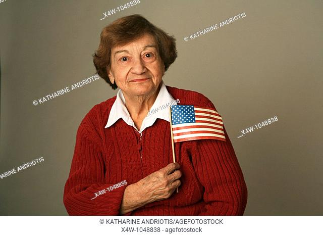 An American senior woman patriot holding flag