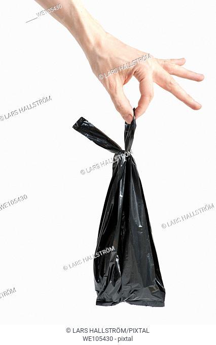 Hand holding Garbage Bag