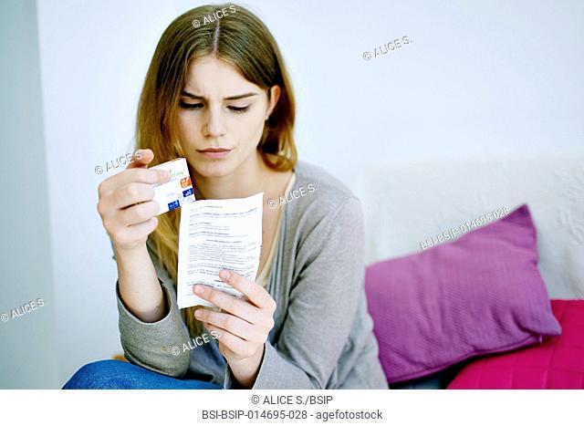 Woman reading paroxetine instruction sheet
