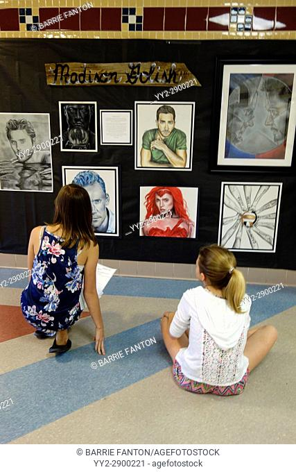 Middle School Girls Critiquing High School Artwork for Art Class, Wellsville, New York, USA