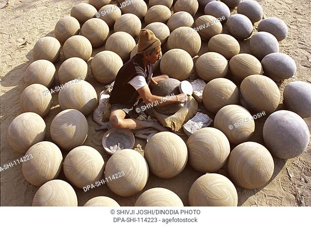 Pottery ; potter giving shape to clay pots ; Bikaner ; Rajasthan ; India