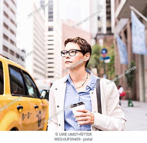 USA, New York City, confident businesswoman in Manhattan