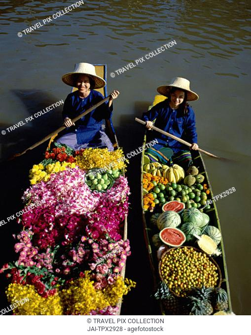 Damnoen Saduak / Floating Market / Female Vendors Selling Fruit and Flowers, Bangkok, Thailand
