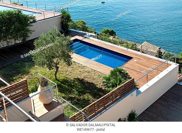 overhead view of a mediterranean sea front house, costa brava,roses, Girona, Catalonia, Spain