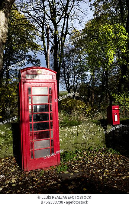 Telephone box and mailbox with trees. Linton, Grassington, Yorkshire Dales, North Yorkshire, Skipton, UK