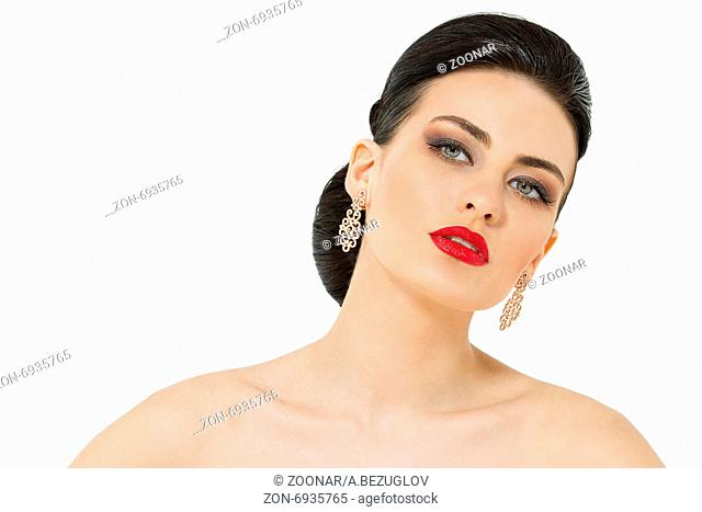 Close portrait of sexy brunette with bright lipstick on an isola