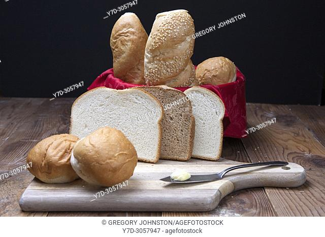 Assorted breads such as sliced bread, rolls, and baguettes on display