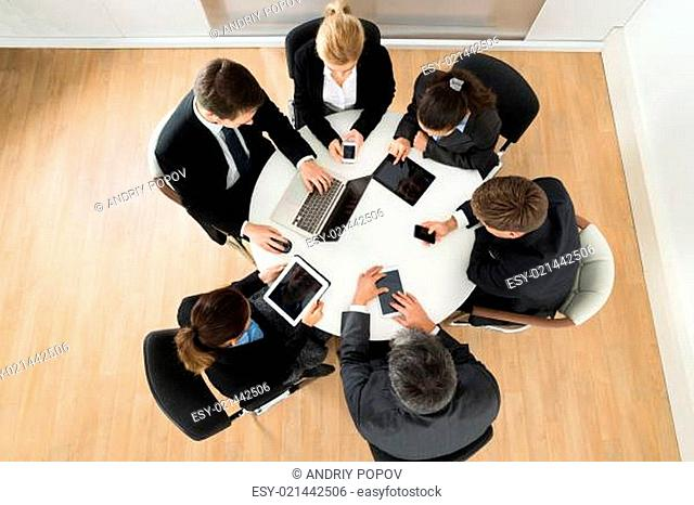 Businesspeople Using Different Electronic Device