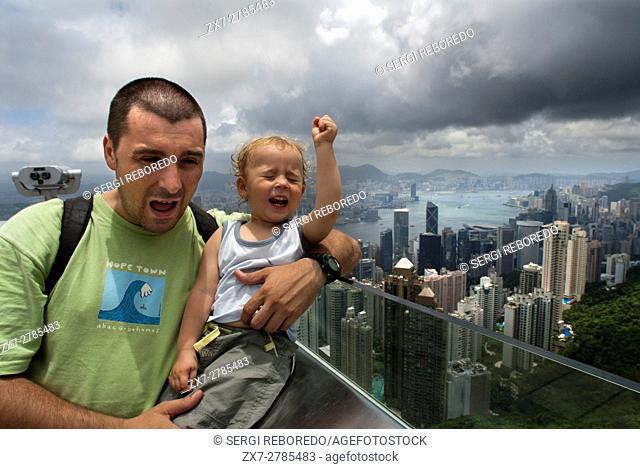 Hong Kong skyline. Panoramic view of Hong Kong and Kowloon from Victoria Peak Tower. Hong Kong, China, SAR, Father with his child