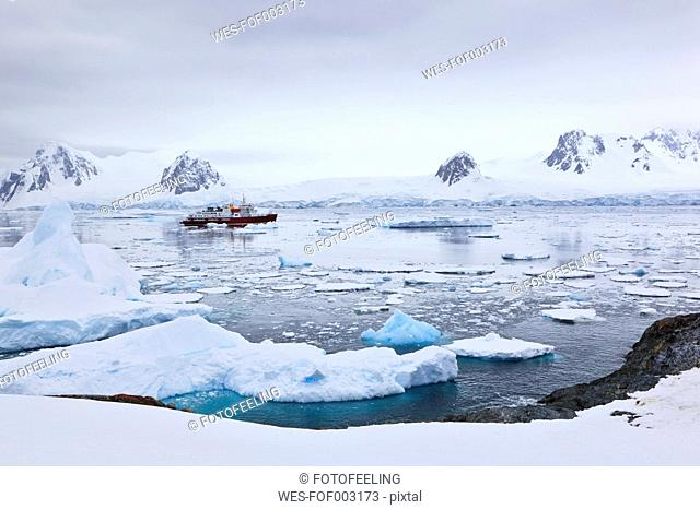 South Atlantic Ocean, Antarctica, Antarctic Peninsula, Lemaire Channel, Yalour Islands, Polar Star icebreaker cruise ship between icebergs on sea