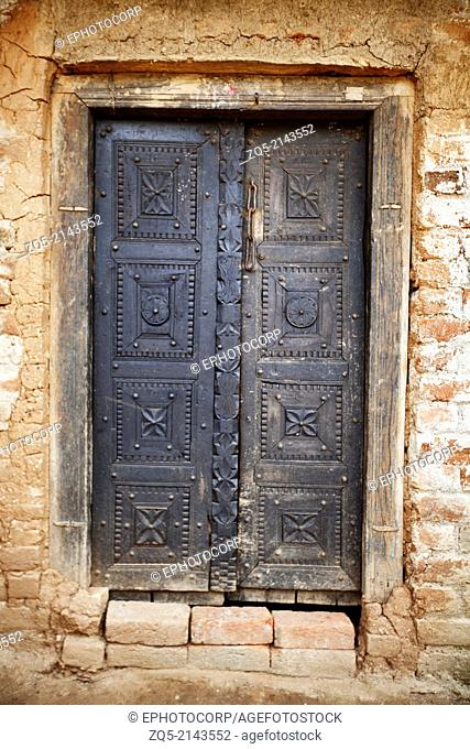 Entrance door of traditional tribal house. Jamuniatand village, Bokaro district, Jharkhand