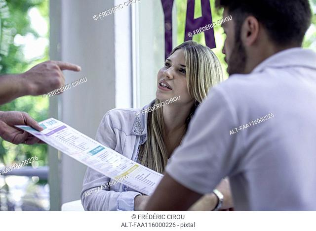 Waitress helping customer
