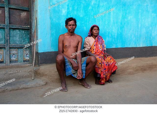 Tribal couple sitting outside home, KHARIA TRIBE, Kurangamal village, Chattisgarh, India