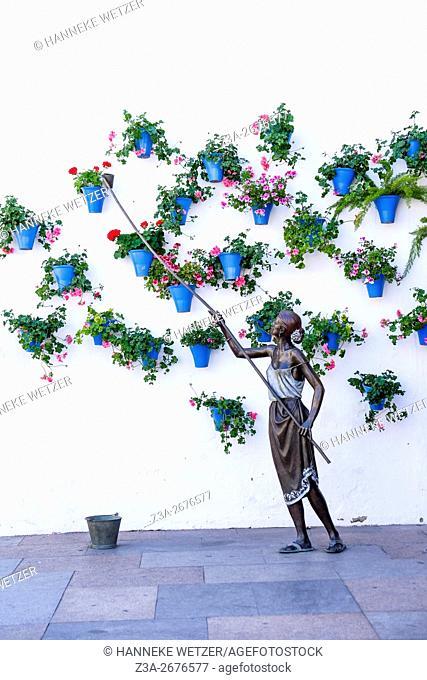 Sculpture of a woman watering flowers in Cordoba, Spain, Europe