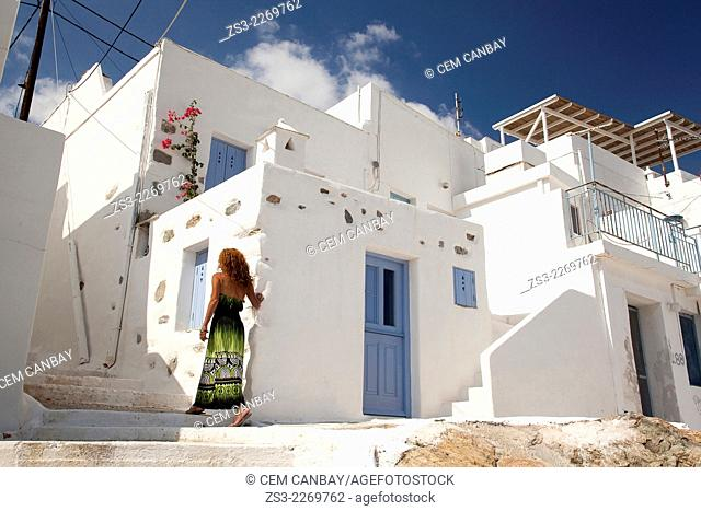 Woman in front of the houses in Hora, Serifos, Cyclades Islands, Greek Islands, Greece, Europe