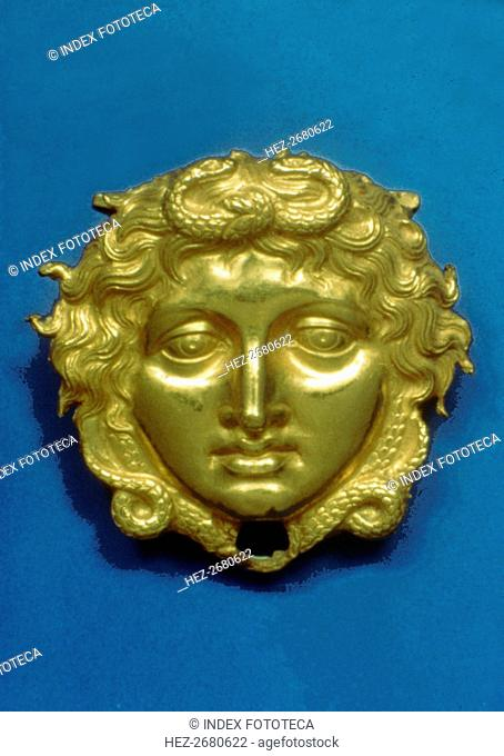 Head of the Gorgon Medusa in embossing gold, piece from the royal tomb at Vergina (350 BC)