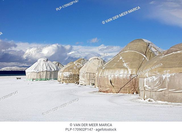 Yurts in traditional Kyrgyz yurt camp in the snow along Song Kul / Song Kol lake in the Tian Shan Mountains, Naryn Province, Kyrgyzstan
