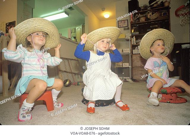 Three little girls wearing sombreros at their daycare center, Washington D.C