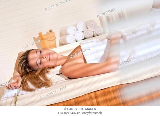 Spa - Young woman at wellness massage relaxing