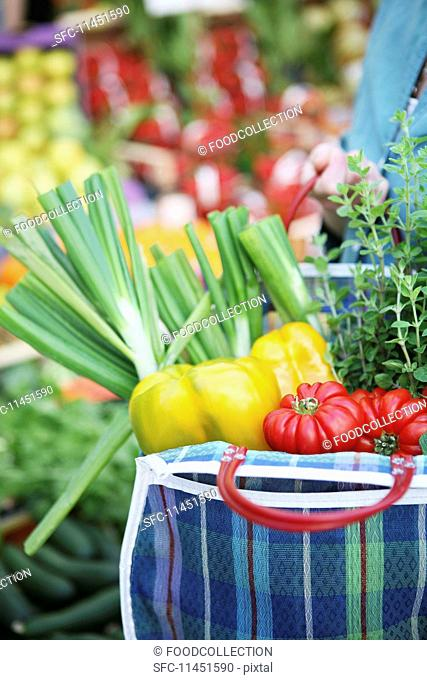 Fresh vegetables in a shopping bag