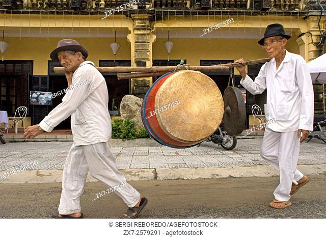 Musicians with bass drum, Hoi An, Vietnam. Street Scene / Building Shop Front / Traditional Arcitecture, Hoi An, Vietnam. Quang Nam, Hoi An old town