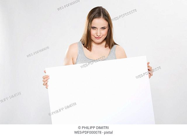 Young woman with blank board, portrait