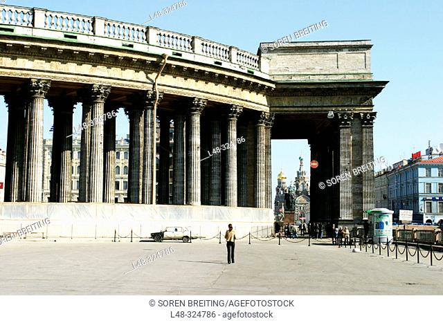 Stone colonnade of The Kazan Cathedral (Kazanskii Sobor) at Nevskii Prospekt, St. Petersburg, Russia. In background Church of Our Savior on the Spilled Blood
