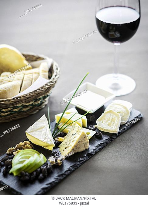 cheese bread and wine tapas snack platter set on restaurant table