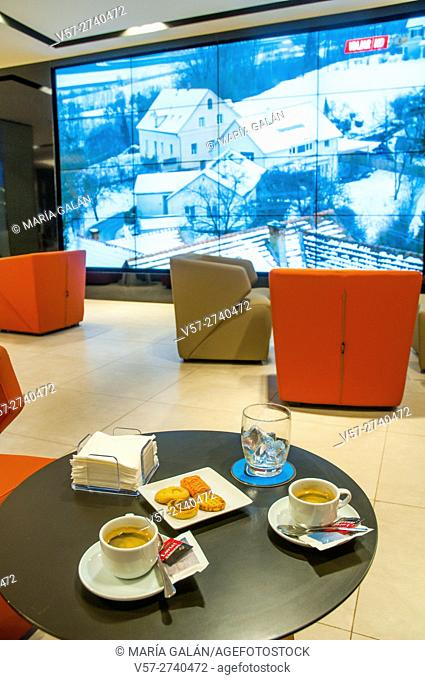 Two cups of coffee and biscuits in a modern cafe. Madrid, Spain