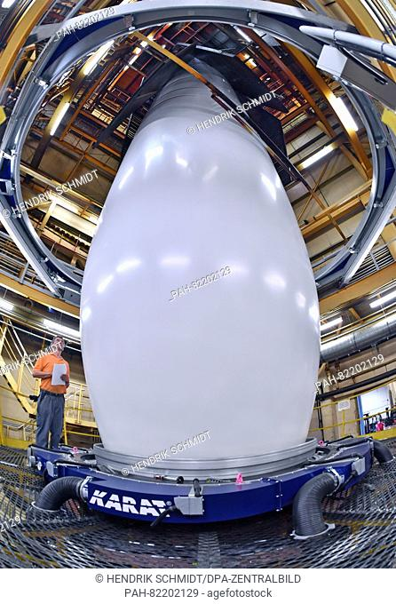 An employee oversees a blowing extrusion machine for manufacturing packaging foil, in the factory of plastics manufacturer POLIFILM in Weissandt-Goelzau