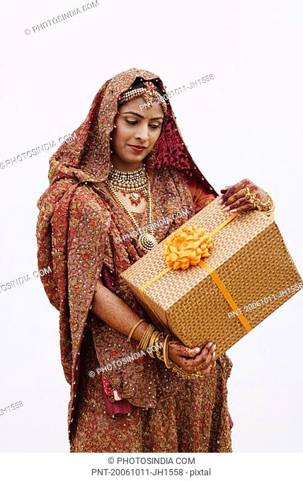 Bride holding a gift