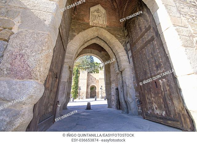 gate in turret of Alcantara bridge, landmark and monument from ancient arab age, in Toledo city, Spain, Europe. Horizontal