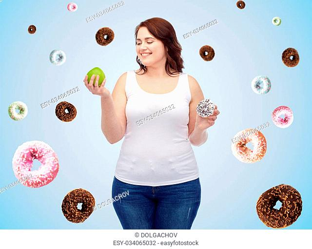 healthy eating, junk food, diet and choice people concept - smiling plus size woman choosing between apple and cookie over blue background