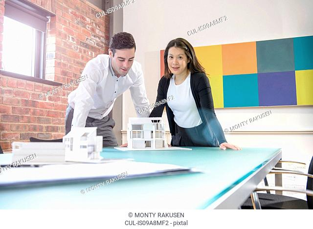 Architect working with colleague in office, portrait