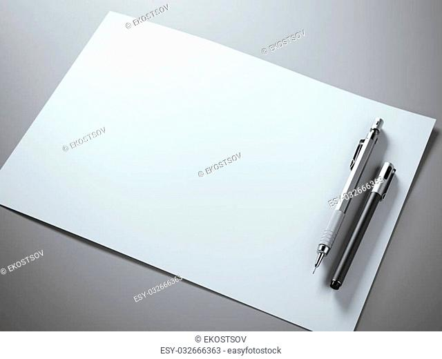 White paper sheet with metal pencil and pen