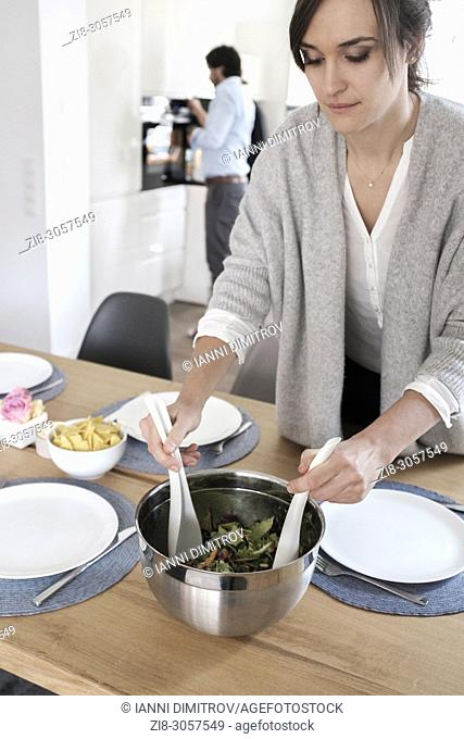 Vegetarian lunch party-woman serving salad