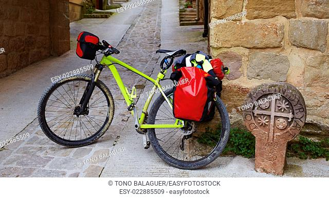 The way of Saint James stone sign in Cirauqui with bike Pamplona Spain