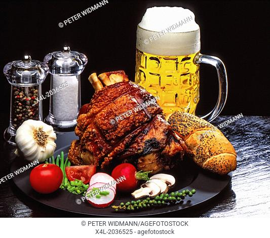 Roast knuckle of pork with crackling with a beer