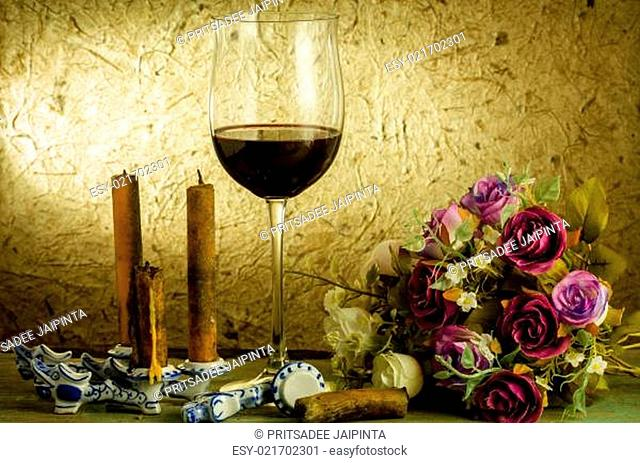 red wine and glass on a old paper background