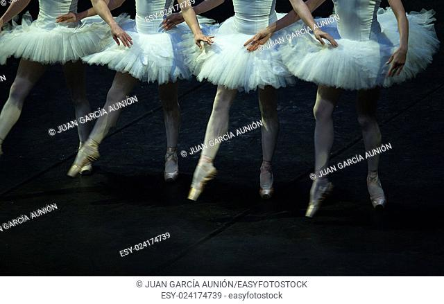 Four hands crossed dancing in the performance of Swan Lake