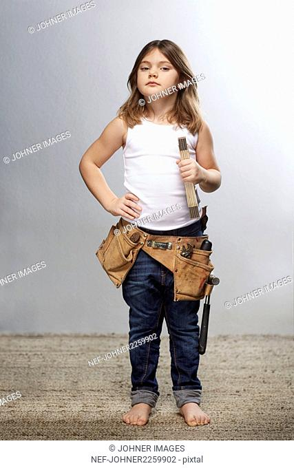 Girl with tool belt