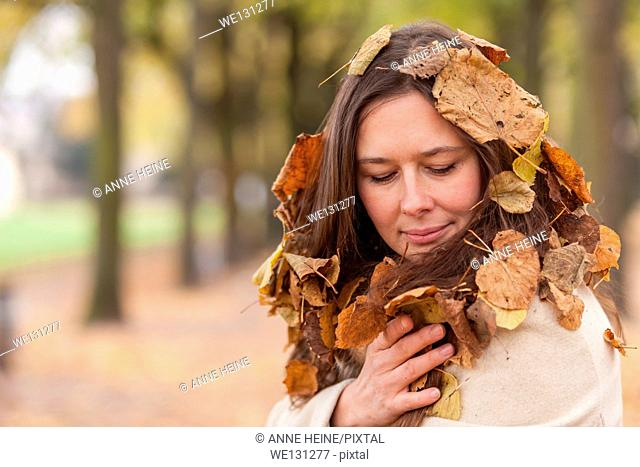 Natural style, woman wrapped in leaves in hair